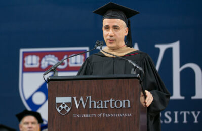 Yuri Milner speaking at lectern during Wharton Commencement